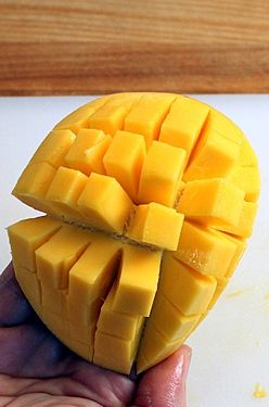 How to peel and cut a mango into cubes slices how to cut a mango an easy step by step tutorial ccuart Gallery
